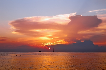 bathers: Beautiful sunset in tropical sea  Silhouettes of ships and bathers