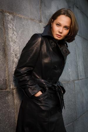 Beautiful young woman near stone wall Stock Photo - 17419860