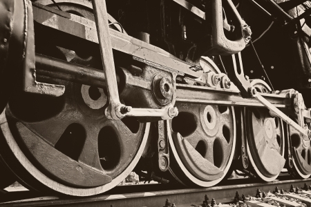 Wheels of vintage steam locomotive photo