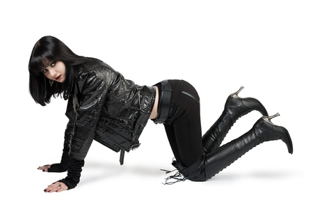 Portrait of young goth woman in lace-up boots over white photo