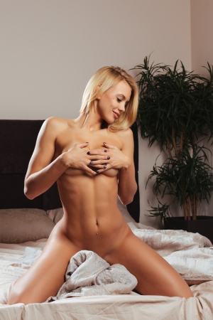 Beautiful young blond woman in bad