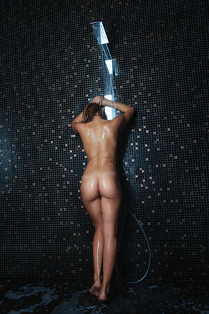 nude body: Beautiful young women standing at the shower