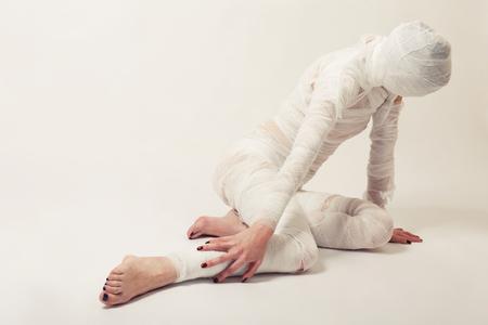 Young beautiful woman with bandage photo