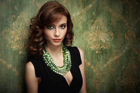 Portrait of pretty young woman with green beads Stock Photo