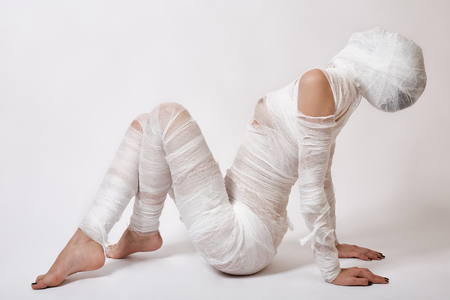 Slim young beautiful woman with bandages in studio