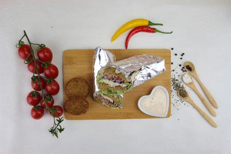 Kebab with tomato on white background