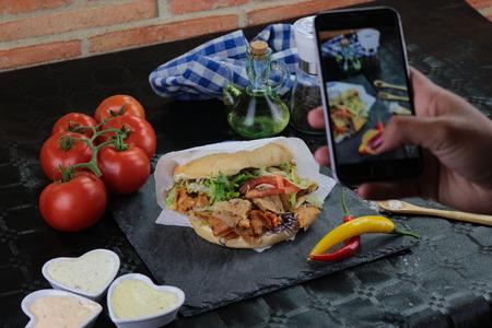 Kebab with tomato on black background