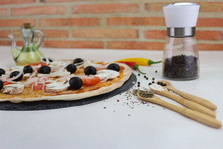 fresh pizza product on table Stock Photo - 121366736