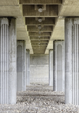 Columns of a bridge, detail of a bridge seen from below, stone bridge