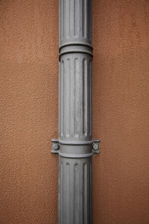 Facade with pipe, metal pipe detail of an ancient Stock Photo - 17352301