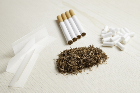cancerous: Types of snuff, cigarettes and snuff rolling, dangerous addiction Stock Photo