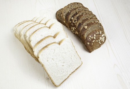 completely: Bread baking, detail of rye bread and regular bread, food