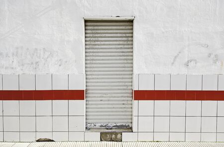 Wall with door closed, abandoned the local detail, exterior detail in the city Stock Photo - 17927708