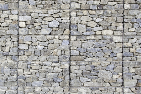 Stone background with texture, detail of a wall decorated with natural stone, textured background Banco de Imagens - 17927742