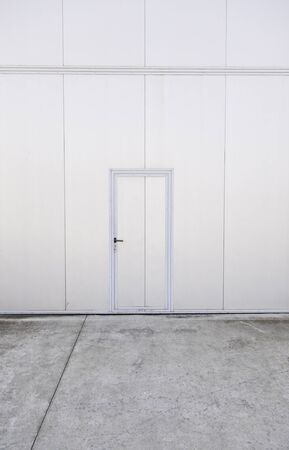 Closed metal door, closed door detail in a factory, protection, textured background Stock Photo - 18285178
