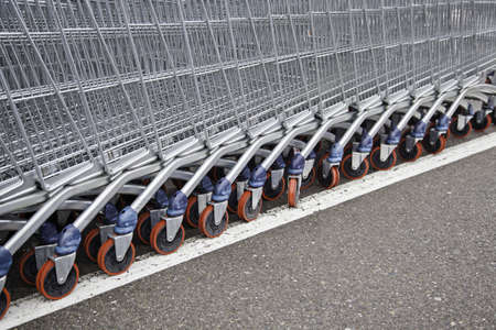 Metal shopping carts, detail row of shopping carts Stock Photo - 18381080