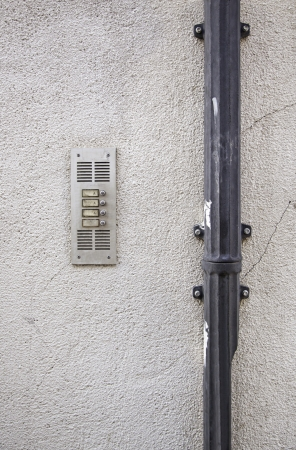 switchgear: Wall with intercom, detail of the city wall, electrical switchgear antiugo detail urban city life