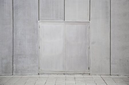 Wall with metal doors, facade detail with metal door in the city protection, metal wall textureWall with metal doors, facade detail with metal door in the city protection, metal wall texture Stock Photo - 18546635