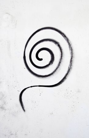 twists: Spiral, a spiral detail in black, cement wall in the city Stock Photo