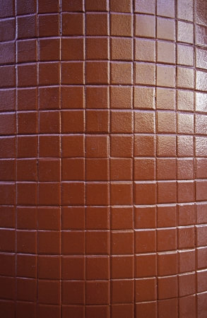 Red tiles, wall detail decorated with bright red tiles, urban decoration Stock Photo