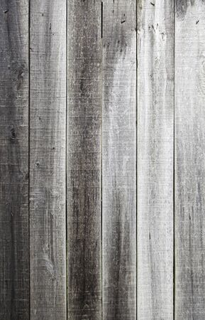 Old rotten wood, detail of a wooden wall damaged, old textured background Stock Photo