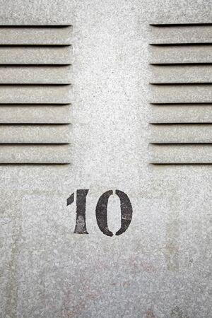 Metal door with number ten, detail of painted metal wall with number ten, decoration in the city Stock Photo - 18827459