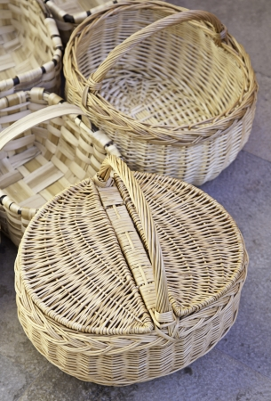 Handmade wicker baskets, baskets detail in the old town, traditional transport things photo