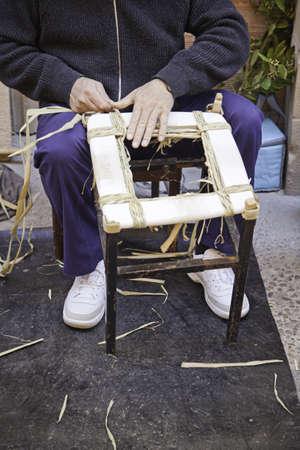 wicker work: Manual worker, detail of man working with wicker work, craft Editorial