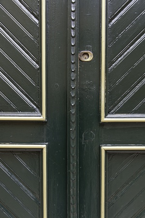 plaster of paris: Former Victorian green door, detail of an old door on the street, with gold decoration