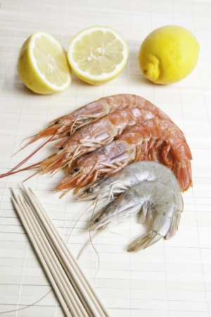 Shrimps and prawns, seafood detail with cut lemons fresh, healthy food
