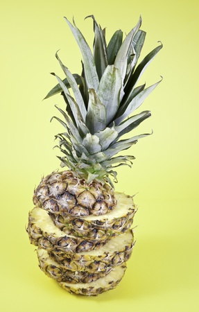 Pineapple cut, detail of exotic fruit on a yellow background, healthy living food, healthy food, diet photo