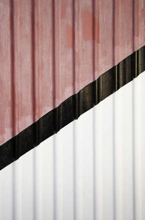 Metal door with colored lines, detail of a painted steel door, decoration in the city photo