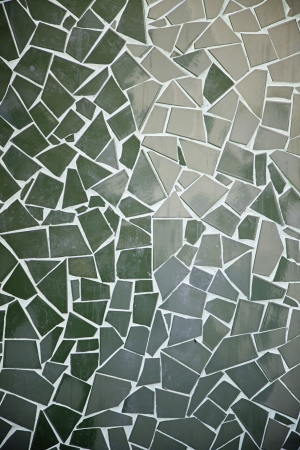 Green tile mosaic, detail of a wall decorated in town, abstract art background