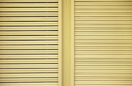 Yellow wood windows, detail of the city, wooden wall detail, textured background photo