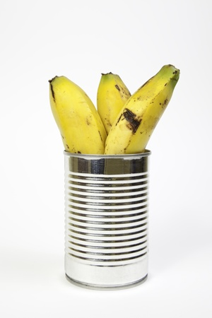 frutta sciroppata: Banane scatola dettaglio frutta in un barattolo, cibo sano, dieta