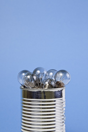 cast off: Bulbs in a can, detail of a electric bulb in a can, broken light bulbs, electricity