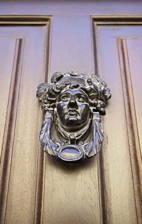 admitted: Former Victorian door, detail of an old door knocker in classic, detail