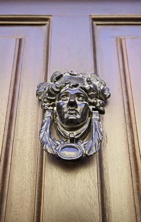 summoning: Former Victorian door, detail of an old door knocker in classic, detail