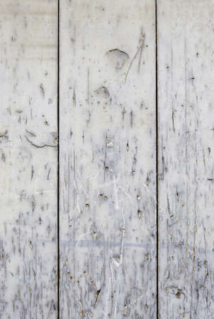 Old wooden background, detail of a wooden textured wall, old and damaged decoration