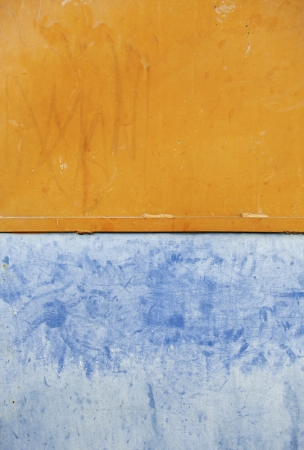 Wall colors, detail of a wall painted colors, orange and blue textured background
