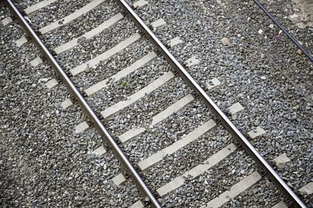 deviate: Train routes, detail of train tracks at a station in the city, textured background, transportation Stock Photo