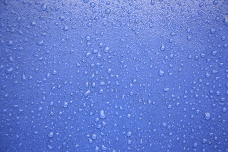 Water drops on blue, detail of a wet blue surface water, rain in the city