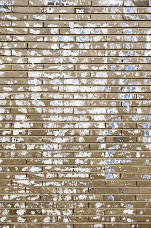 Stained brick wall, detail of a brick wall paper stained photo