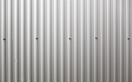 corrugated steel: Corrugated metal wall, detail of a wall lined with metal, shiny steel