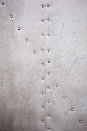 Metal wall texture, detail of a wall with rivets metal background with texture Stock Photo