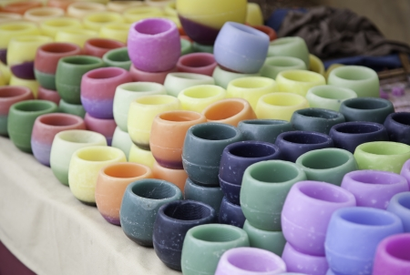 subtly: Colored candles, handmade candles detail in a market in the city, artisan product