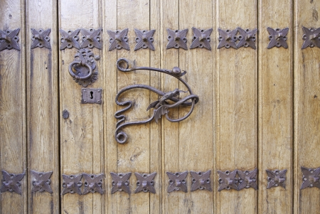 Old door handle, detail of an ancient decorated handle in town, vintage, decoration photo