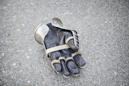 Old medieval glove, detail of an ancient medieval armor, metal glove Stock Photo - 20628541