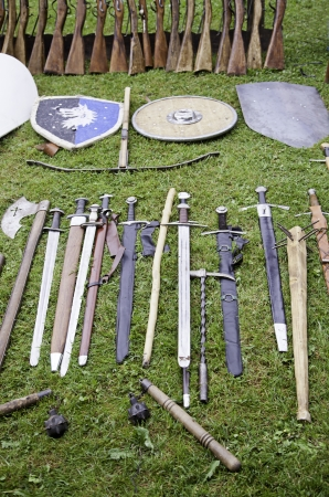 medieval weapons: Shields and swords medieval weapons detail of ancient medieval times, ancient weapon  Stock Photo