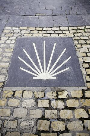 Symbol of the Camino de Santiago, detail of an information signal for pilgrims Stock Photo